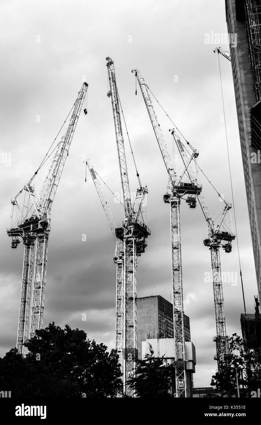 UK residential real estate property industry: Tower cranes on the South Bank Tower construction site, South Bank, Stock Photo