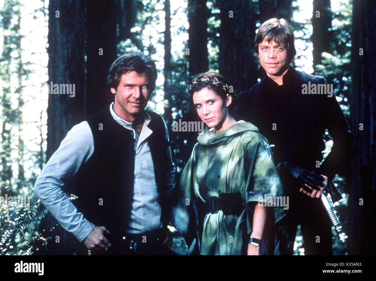 Photo Must Be Credited ©Supplied by Alpha 070000 (1983) Harrison Ford as Hans Solo, Carrie Fisher as Princess Leia and Mark Hamill as Luke Skywalker in Star Wars The Empire Strikes Back movie - Stock Image