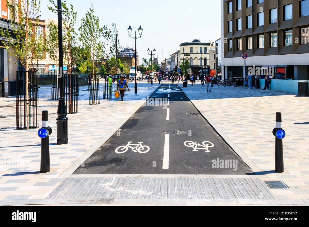 Cycle lanes in 'Navigator Square', the newly pedestrianised centre of Archway, North London - Stock Image