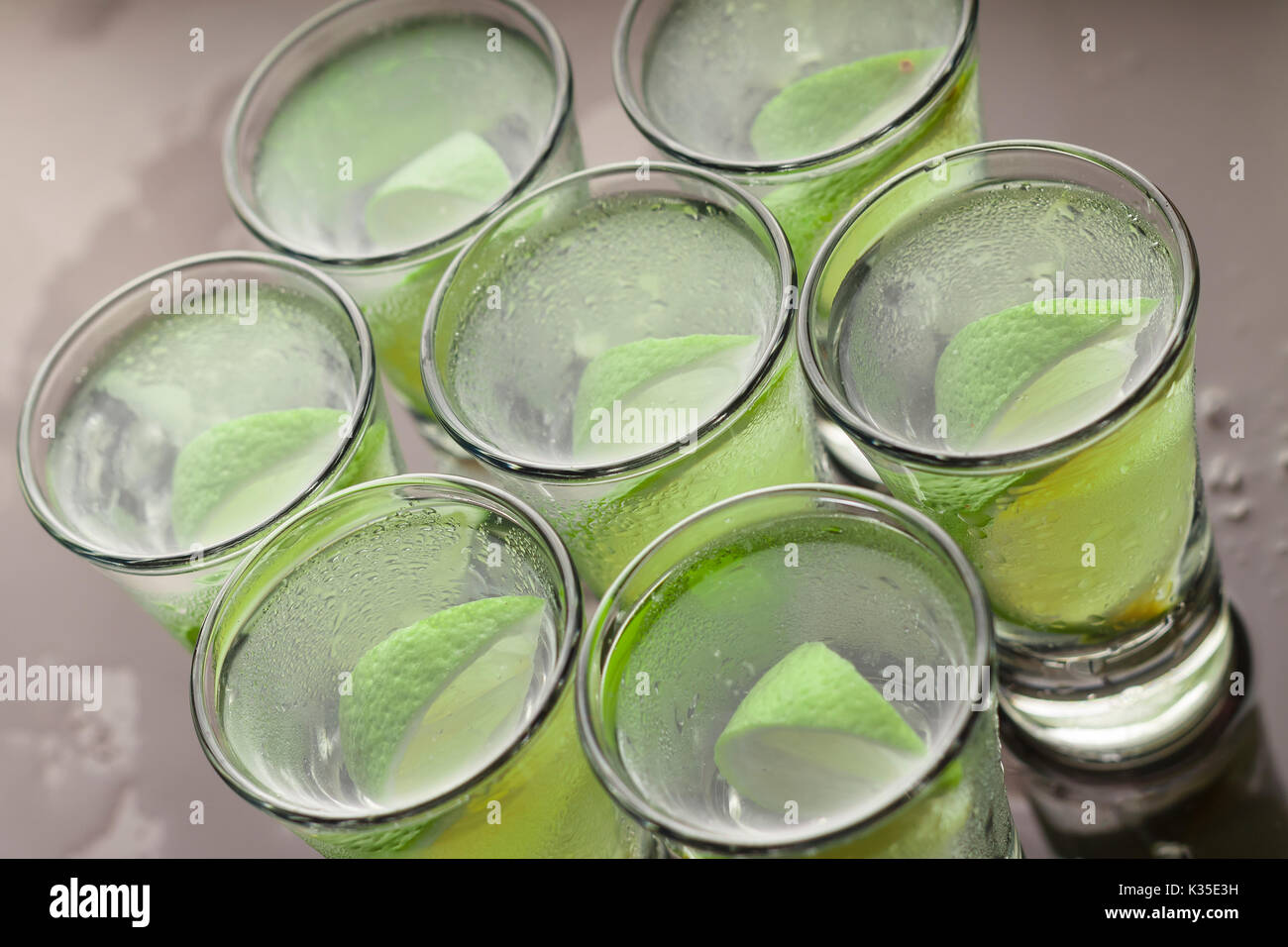 Alcohol cocktail with lime - Stock Image