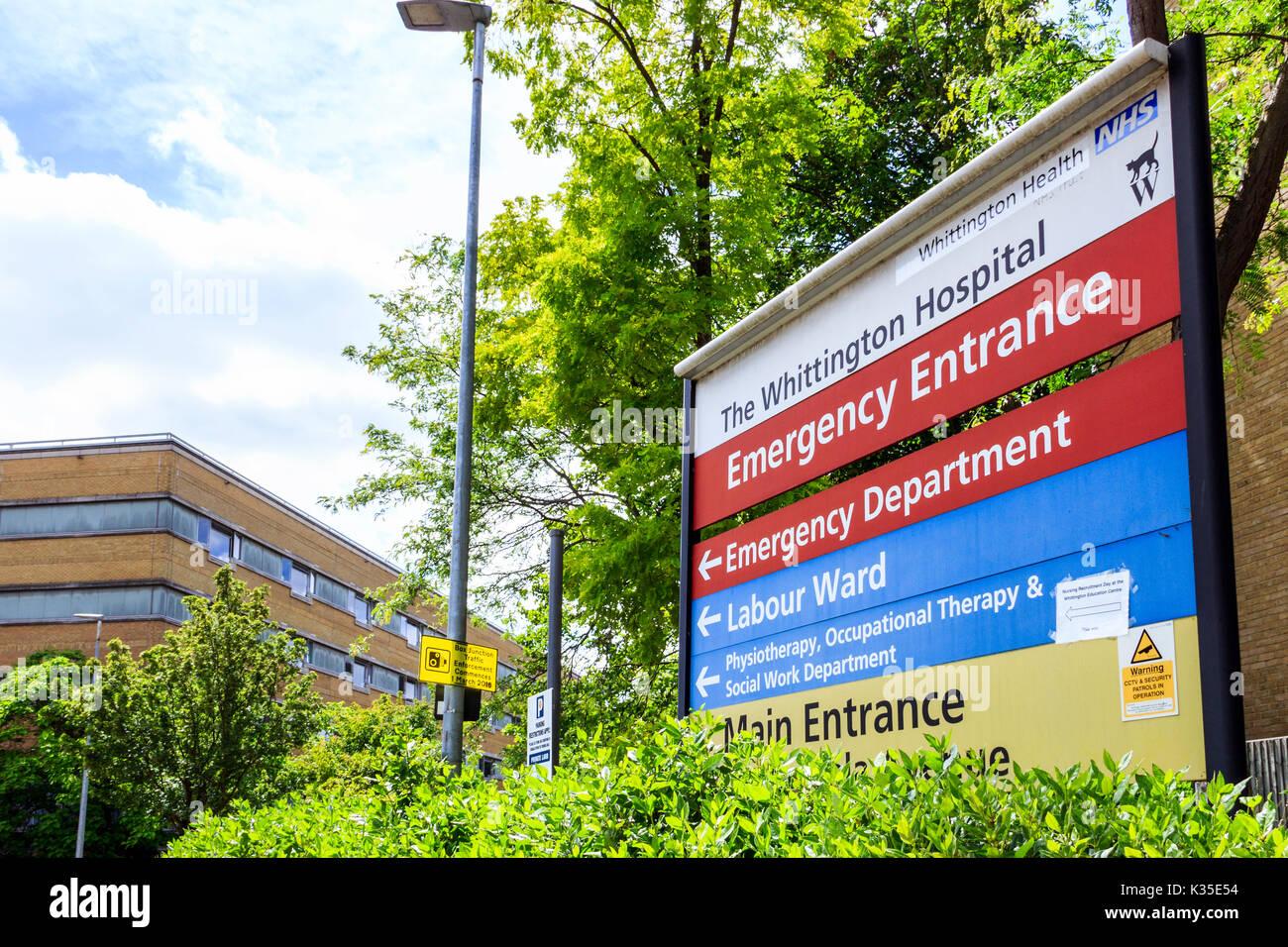 Informational sign showing the Emergency Entrance of the Whittington Hospital, Archway, North London, UK - Stock Image