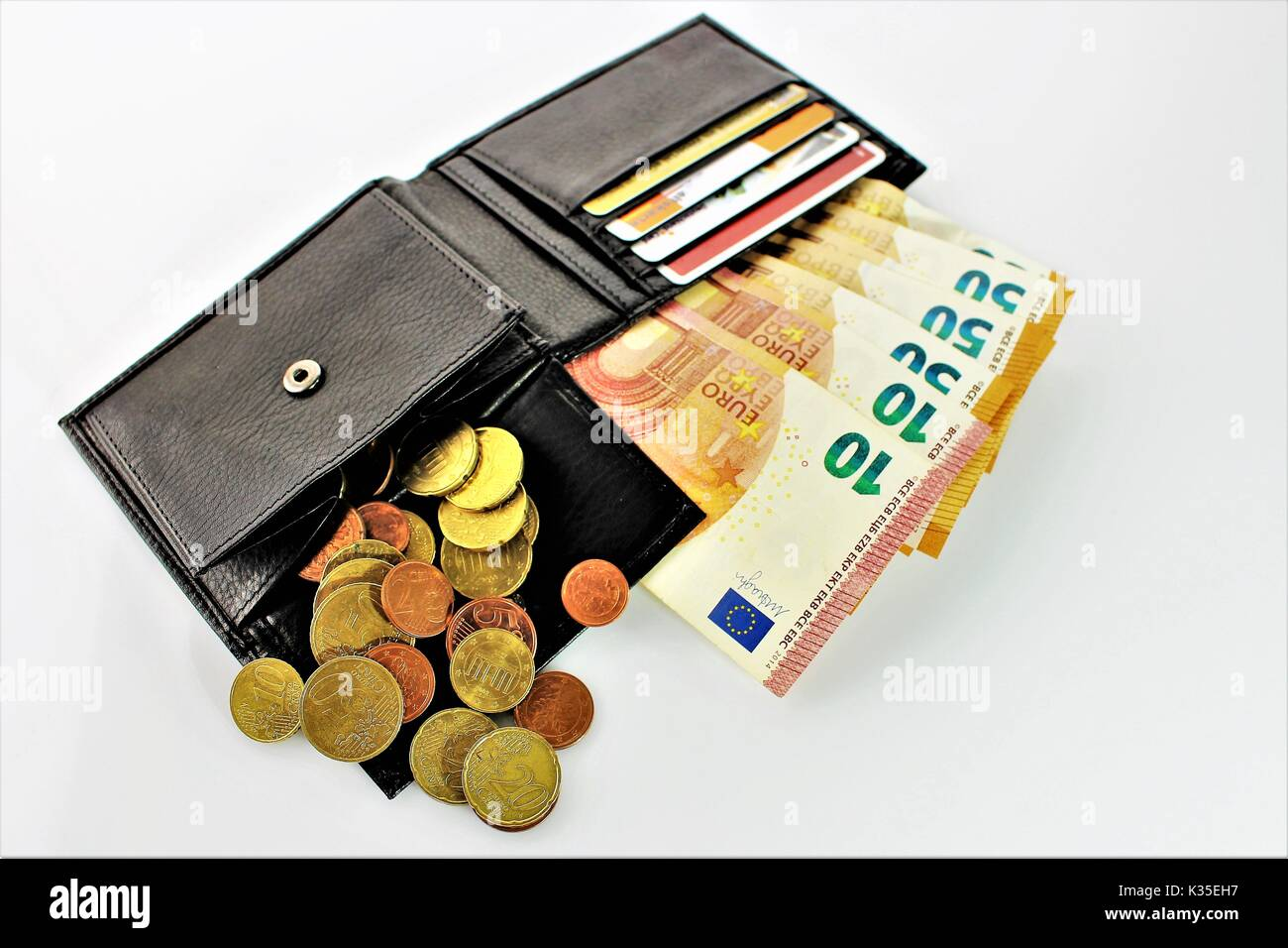 An image of a purse with money - Stock Image