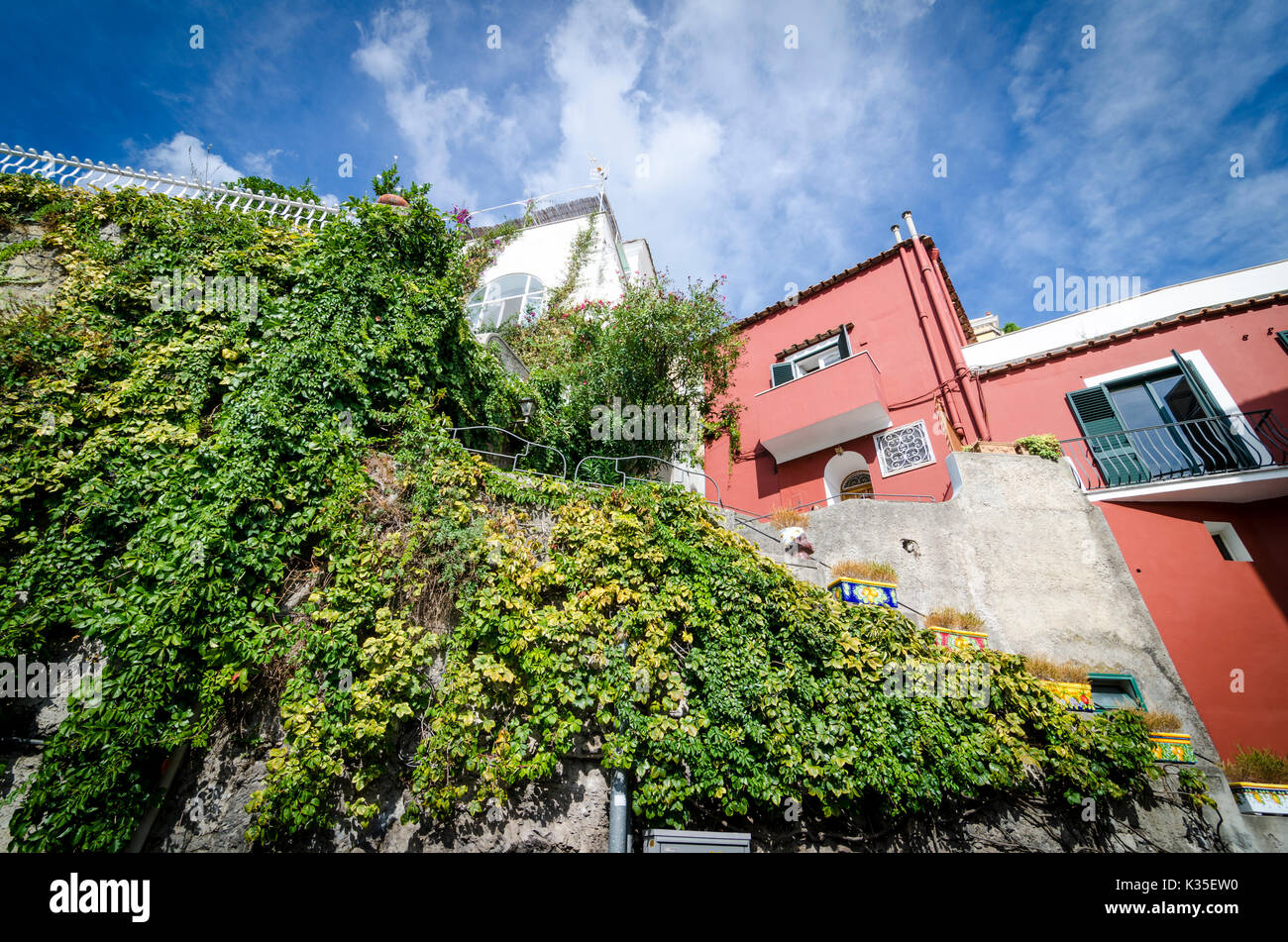 Dramatic view looking up at cliffside houses in Positano, Italy on the Amalfi Coast. Stock Photo