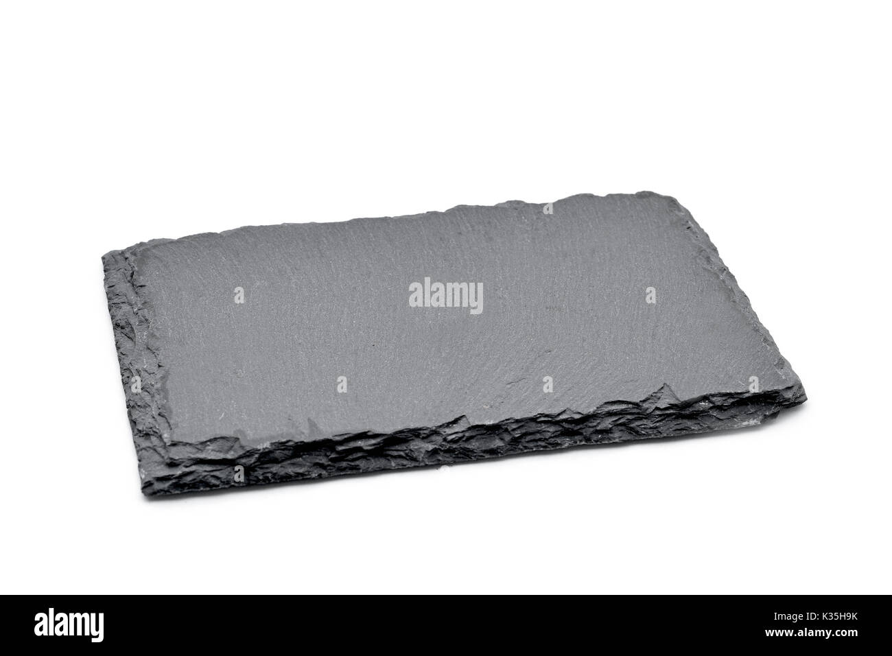 a rectangular piece of slate stone on a white background - Stock Image