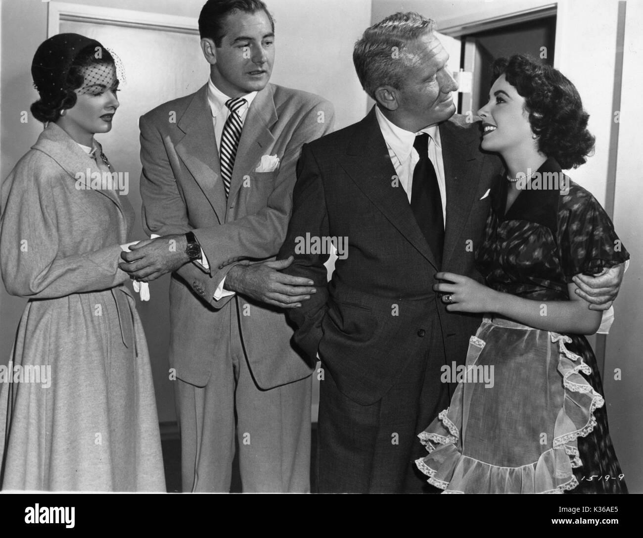 FATHER'S LITTLE DIVIDEND (US1951) L-R, JOAN BENNETT, DON TAYLOR, SPENCER TRACY, ELIZABETH TAYLOR - Stock Image