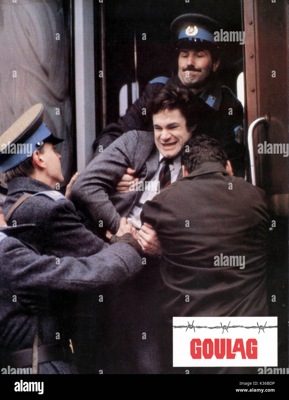 GULAG David Keith as Mickey Almon being arrested by the KGB     Date: 1985 - Stock Image