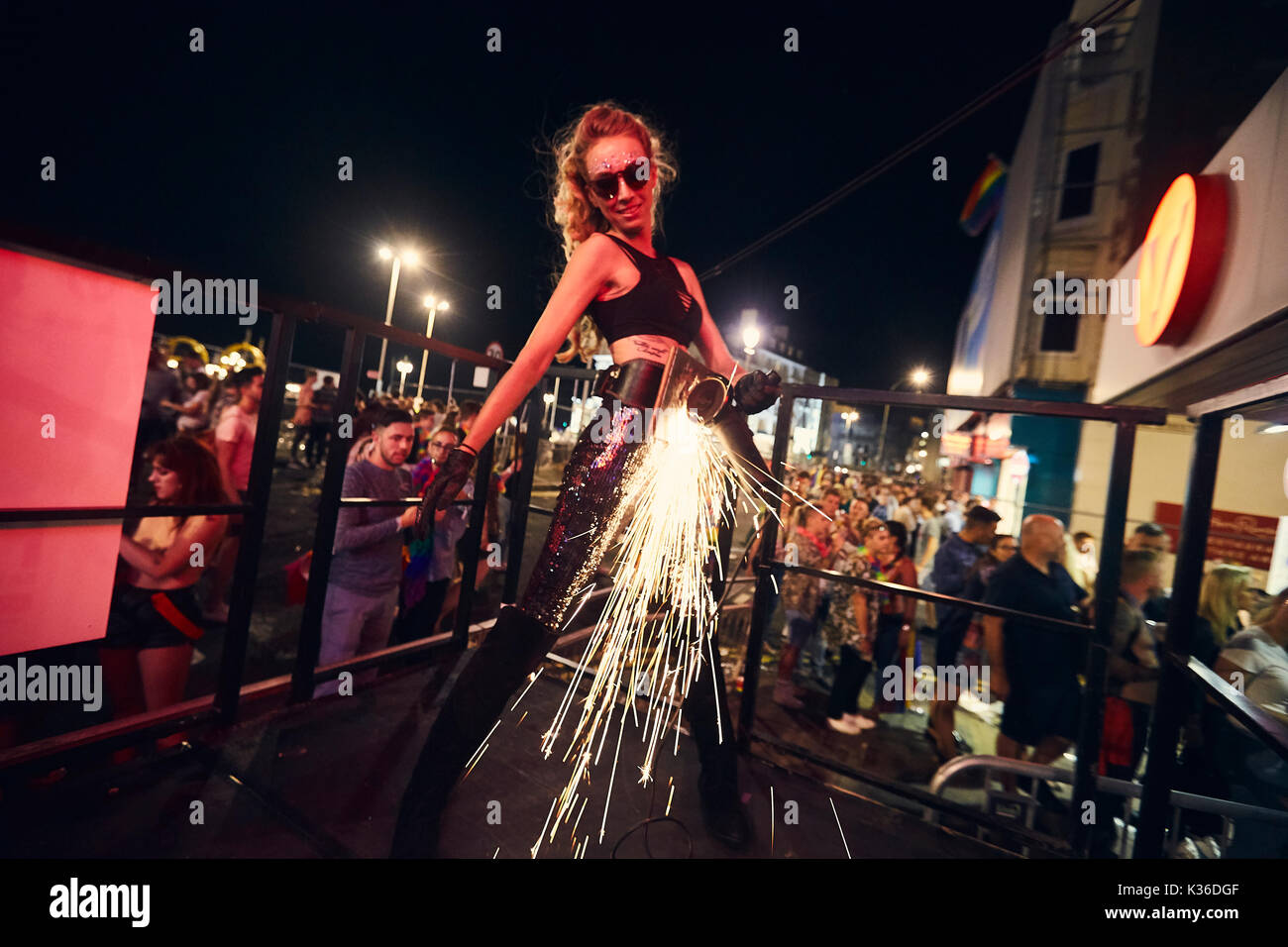 Brighton/ United Kingdom - AUGUST 05 2017: Brighton Gay pride weekend opening party held at St James Street. A female performer uses an angle grinder on stage - Stock Image