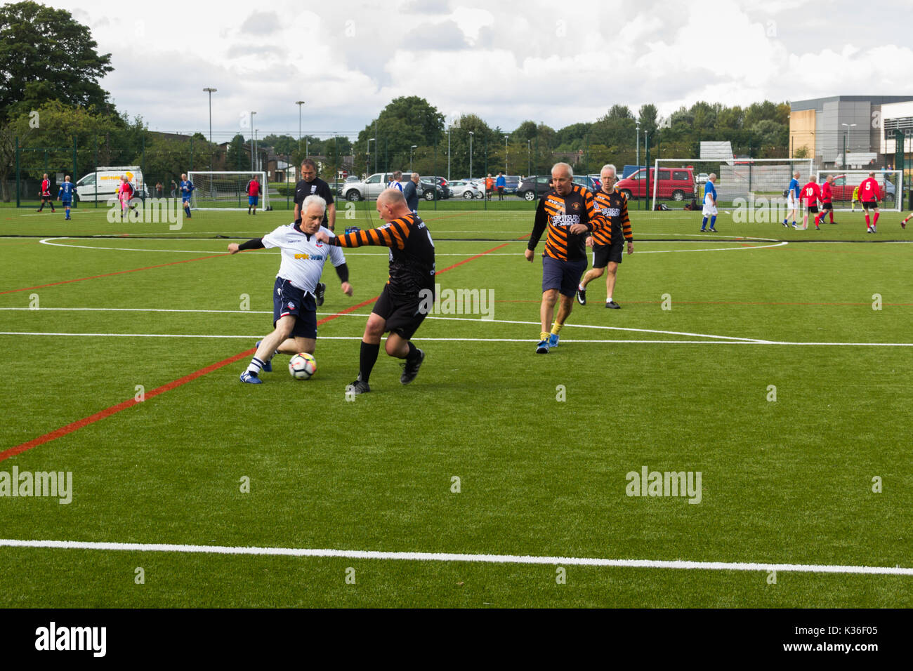 Heywood, Greater Manchester, UK. 1st Sep, 2017. Today saw the kick-off of the second season for the Greater Manchester Over 60s Walking Football league at Heywood Sports Village. David Mort, playing for Bolton Wanderers A, shows considerable body swerve against his Roach Dynamos opponent. Walking Football is one of the fastest growing areas of organised football in the UK, aimed at increasing health and fitness through physical activity in the over 50s, encouraged by football clubs, health professionals and the Football Association. Credit: Joseph Clemson/Alamy Live News - Stock Image