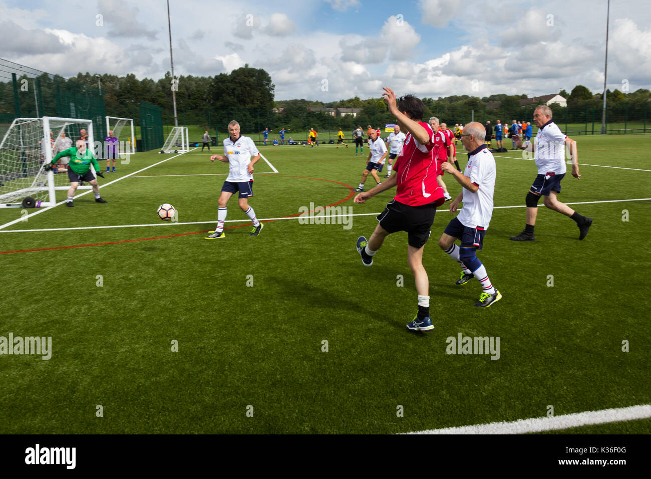 Heywood, Greater Manchester, UK. 1st Sep, 2017. Today saw the kick-off of the second season for the Greater Manchester Over 60s Walking Football league at Heywood Sports Village. Bury Relics in red beat Bolton Wanderers B 2-1 in their opening game. Walking Football is one of the fastest growing areas of organised football in the UK, aimed at increasing health and fitness through physical activity in the over 50s, encouraged by football clubs, health professionals and the Football Association. Credit: Joseph Clemson/Alamy Live News - Stock Image