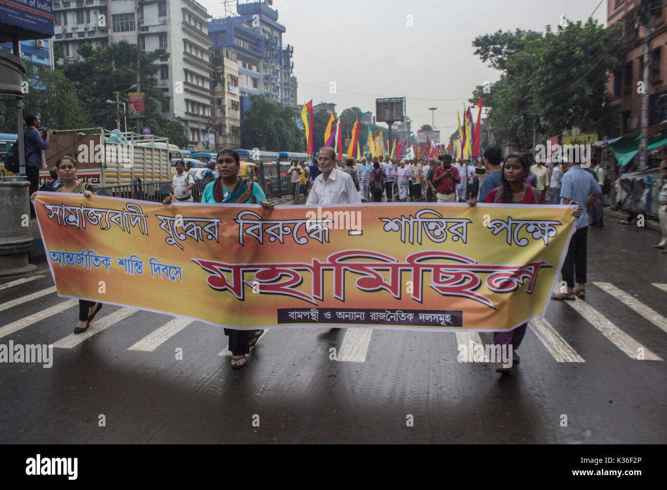 Kolkata, India. 01st Sep, 2017. kolkata,India, 01 september, 2017. Leftist party workers display a poster in an anti-imperialist rally. Credit: Sudip Maiti/Alamy Live News - Stock Image