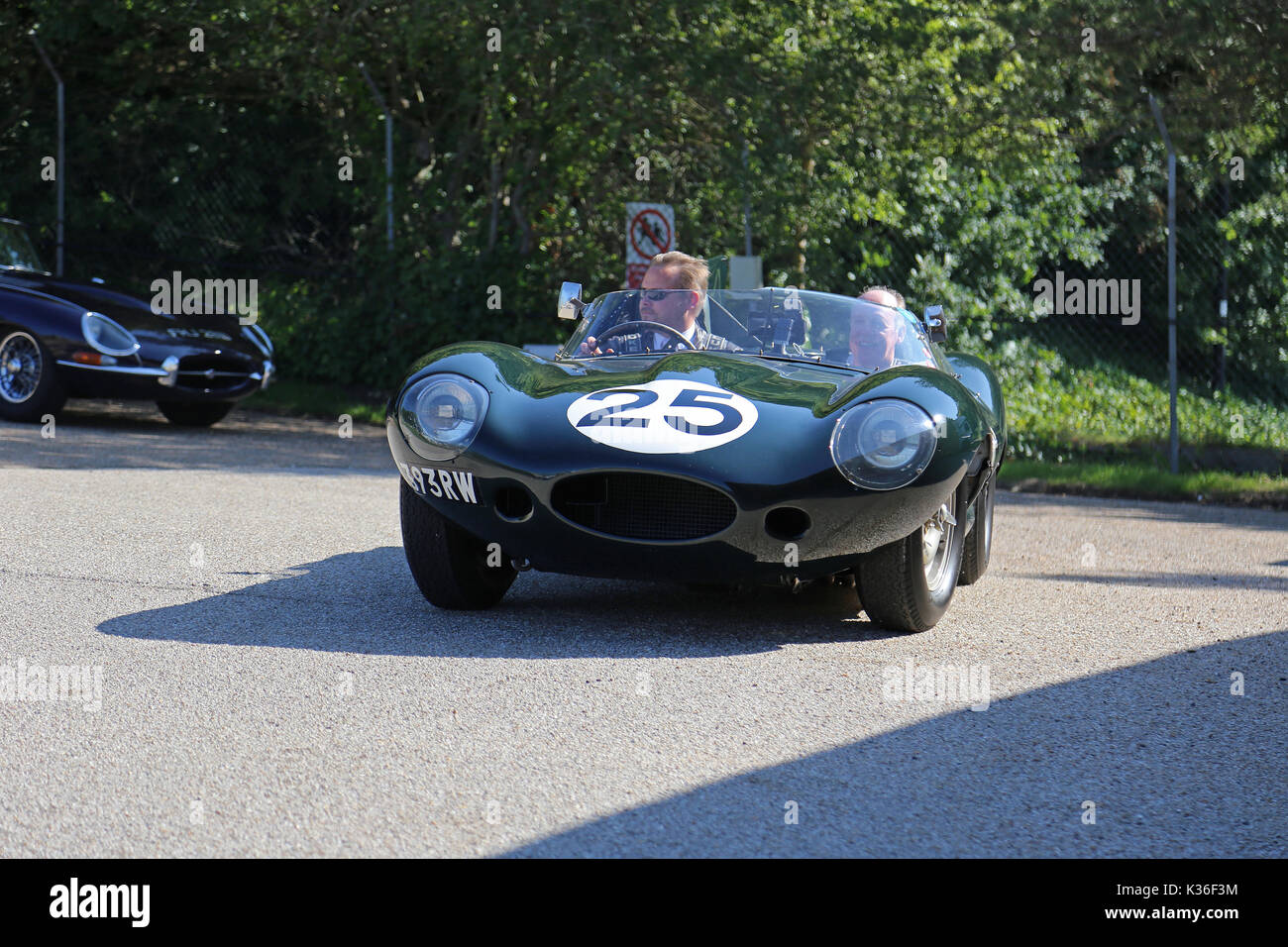 Five historic D-Type Jaguars visit Brooklands circuit, Weybridge, Surrey, England, UK. 1st September 2017. D-Type Jaguars won the Le Mans 24hr endurance race in 1955, 1956 and 1957. In 1957, D-Types were placed 1-2-3-4-6, with only a solitary Ferrari in 5th spoiling the parade. In picture, car numbered '25' (Jaguar Works, XKD 605, 'long-nose') was 6th at Le Mans in 1956. - Stock Image