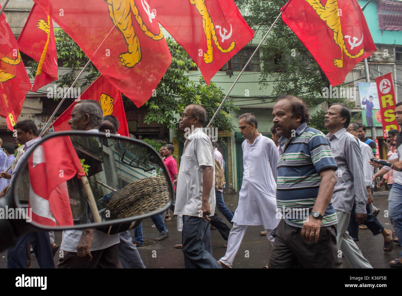 Kolkata, India. 01st Sep, 2017. kolkata,India, 01 september, 2017. People carrying the party flags in the anti-imperialist rally. Credit: Sudip Maiti/Alamy Live News - Stock Image