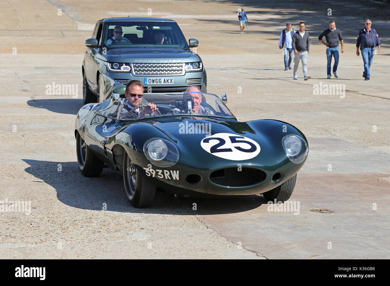 Five historic D-Type Jaguars visit Brooklands circuit, Weybridge, Surrey, England, UK. 1st September 2017. D-Type Jaguars won the Le Mans 24hr endurance race in 1955, 1956 and 1957. In 1957, D-Types were placed 1-2-3-4-6, with only a solitary Ferrari in 5th spoiling the parade. In picture, shown on Finishing Straight, car numbered '25' (Jaguar Works, XKD 605, 'long-nose') was 6th at Le Mans in 1956. - Stock Image