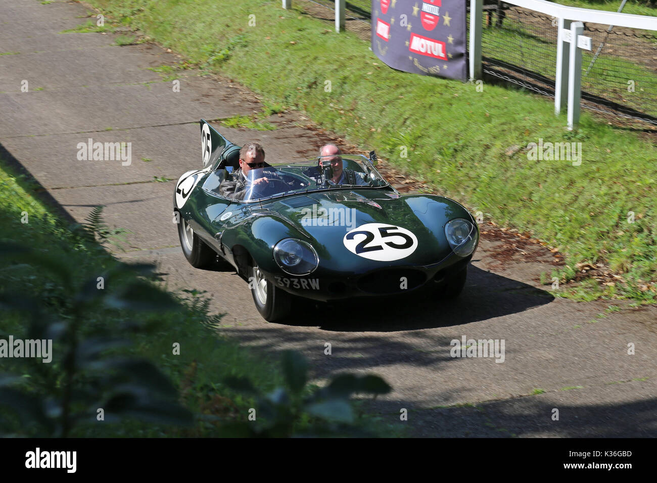 Five historic D-Type Jaguars visit Brooklands circuit, Weybridge, Surrey, England, UK. 1st September 2017. D-Type Jaguars won the Le Mans 24hr endurance race in 1955, 1956 and 1957. In 1957, D-Types were placed 1-2-3-4-6, with only a solitary Ferrari in 5th spoiling the parade. In picture, shown on Test Hill, car numbered '25' (Jaguar Works, XKD 605, 'long-nose') was 6th at Le Mans in 1956. - Stock Image