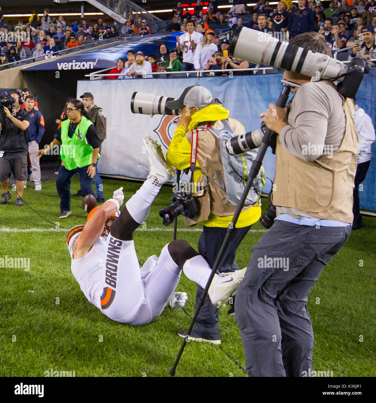 August 31, 2017: Chicago, Illinois, U.S. - Browns #87 Seth DeValve runs into Associated Press Photographer Nam Y. Huh during the NFL Preseason Game between the Cleveland Browns and Chicago Bears at Soldier Field in Chicago, IL. - Stock Image