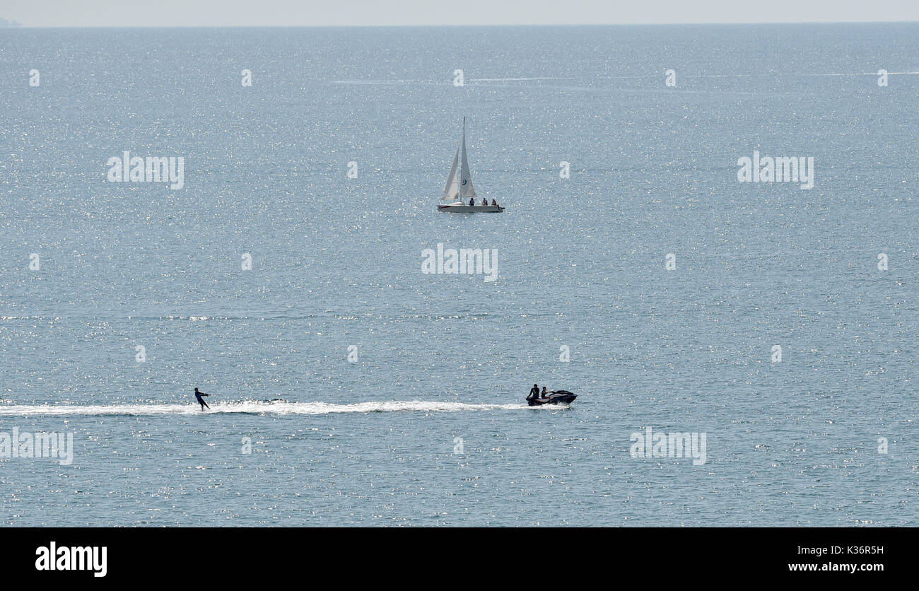 Brighton, UK. 2nd Sep, 2017. Speedboat fun off Brighton beach in the hot sunshine today but wet weather is due to sweep in from the west tomorrow Credit: Simon Dack/Alamy Live News - Stock Image