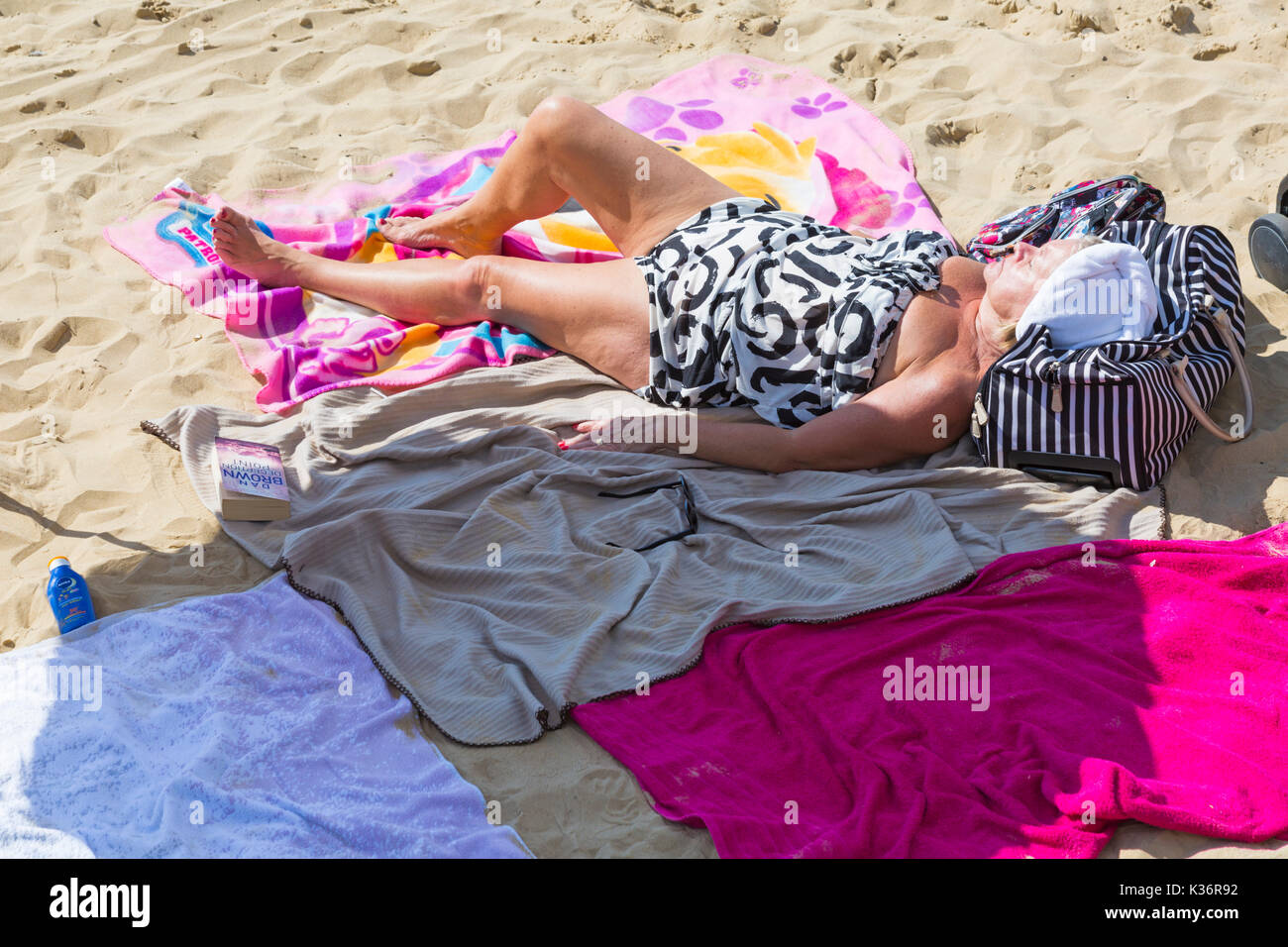 Bournemouth, Dorset, UK. 2nd Sep, 2017. UK weather: lovely warm sunny day at Bournemouth beach. Mature woman lying on beach sunbathing, relaxing in the sunshine. Credit: Carolyn Jenkins/Alamy Live News - Stock Image
