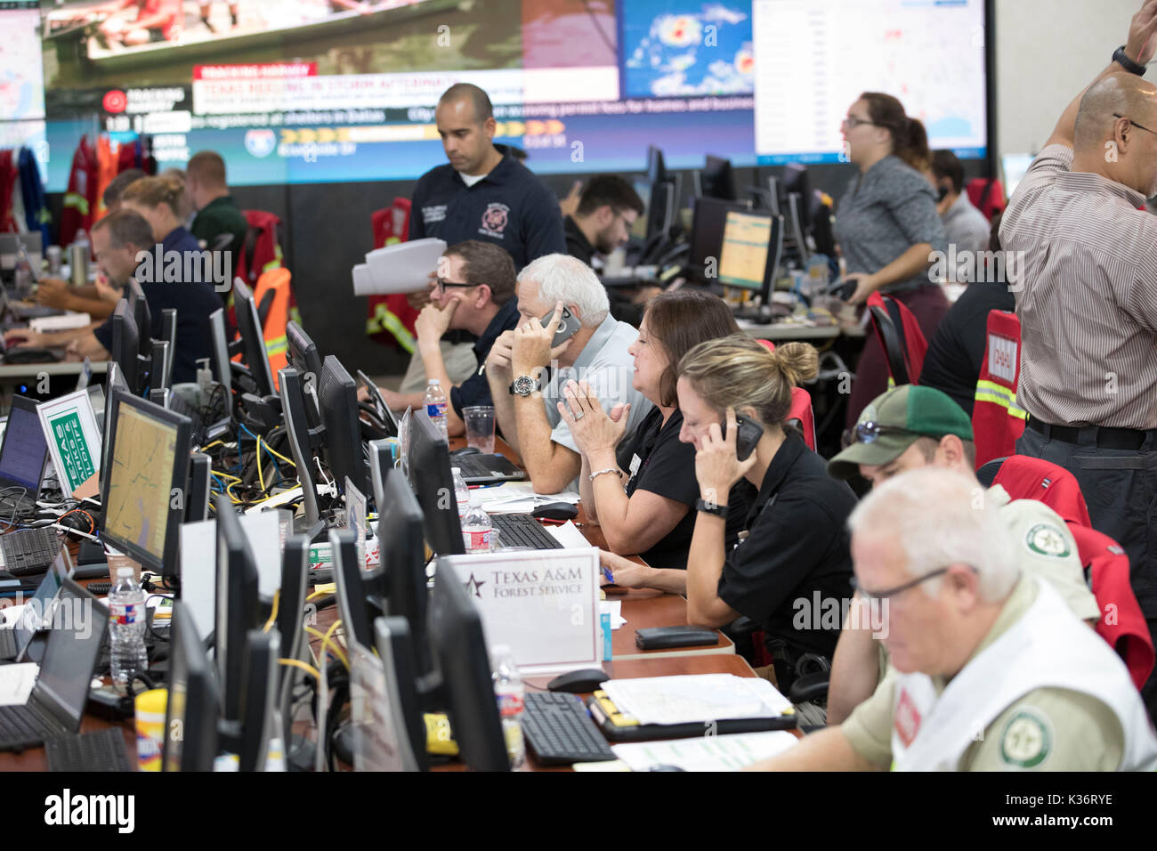 Austin, Texas USA Sept. 1, 2017: Emergency response officials and staff at the Texas Department of Public Safety Emergency Operations Center in Austin monitor the unfolding disaster of flooding in Southeast Texas from Hurricane Harvey. Credit: Bob Daemmrich/Alamy Live News - Stock Image