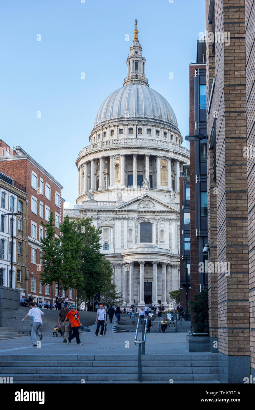 Evening view of St Paul's Cathedral, City of London, with skaters on the steps from Milennium Bridge. - Stock Image
