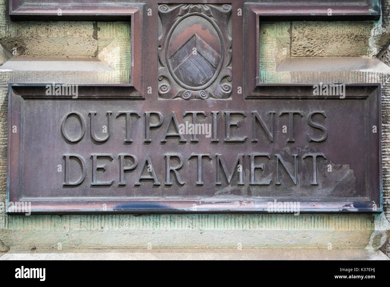 LONDON, UK - AUGUST 11TH 2017: A metal plaque at the Outpatients Department at St. Bartholomews Hospital in the City of London, on 11th August 2017. - Stock Image