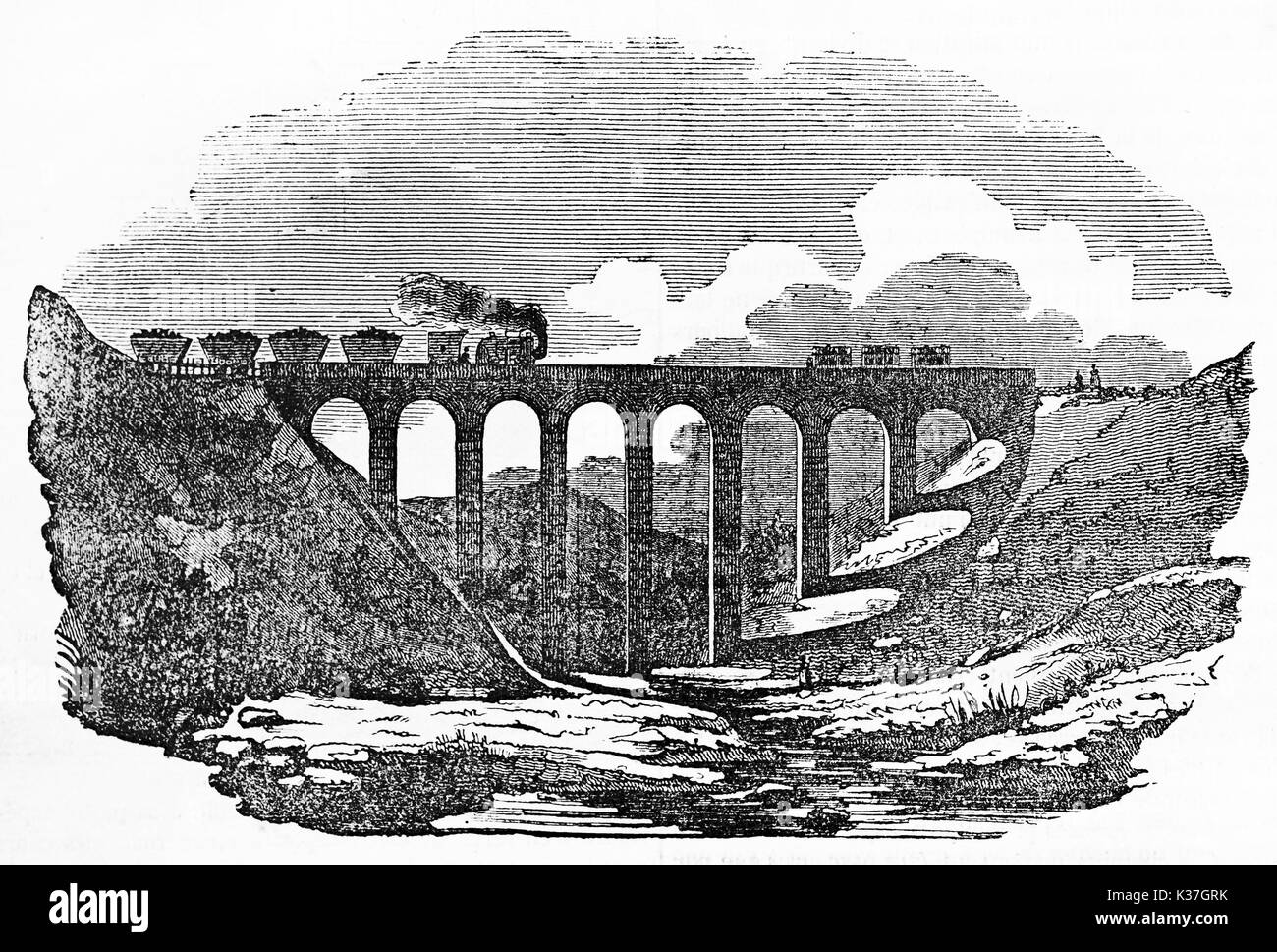 Overall Ancient View Of A Arched Stone Bridge With A Train Passing On Stock Photo Alamy
