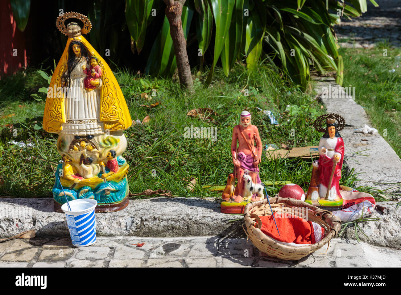 Santeria dolls and religious offerings and icons of saints