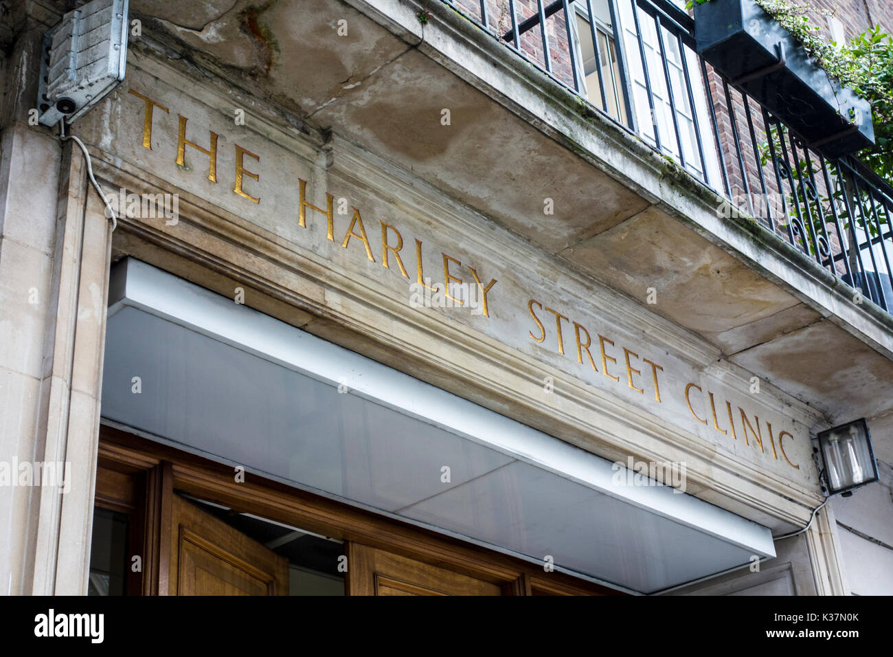 The Harley Street Clinic sign above an entrance, London - Stock Image