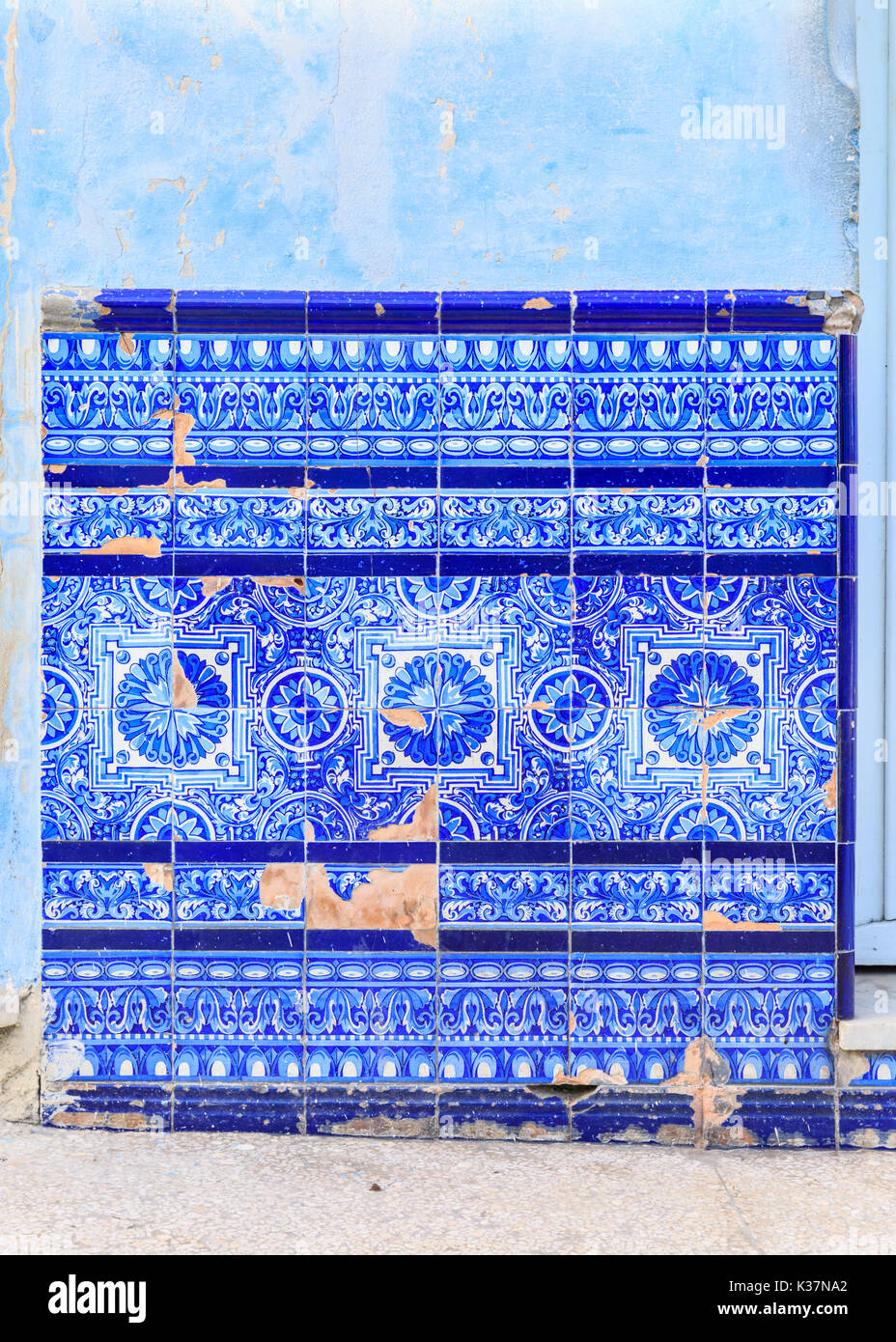 Blue Spanish or Portuguese Mediterranean heritage azulejos tiles on wall in Havana, Cuba - Stock Image