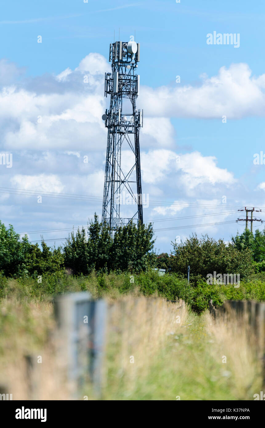 Mobile phone mast aeriel radio transmitter antenna in the countryside - Stock Image