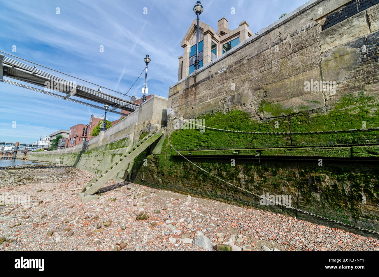 Steps into the exposed river bed of the Thames at low tide. London, UK Stock Photo