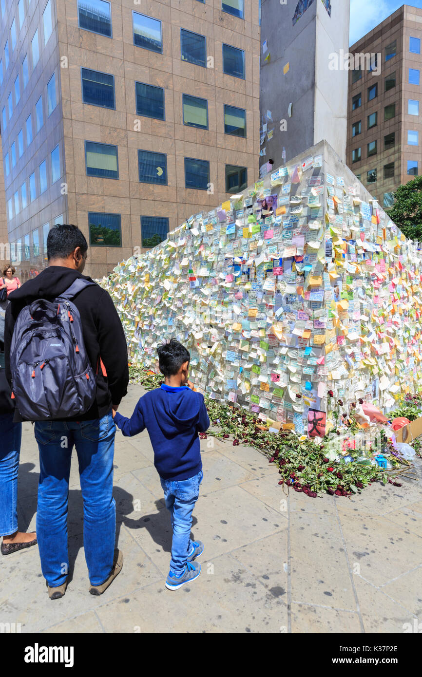 People look at wall of condolence cards, notes, tributes and flowers at vigil near the scene of the 2017 London - Stock Image