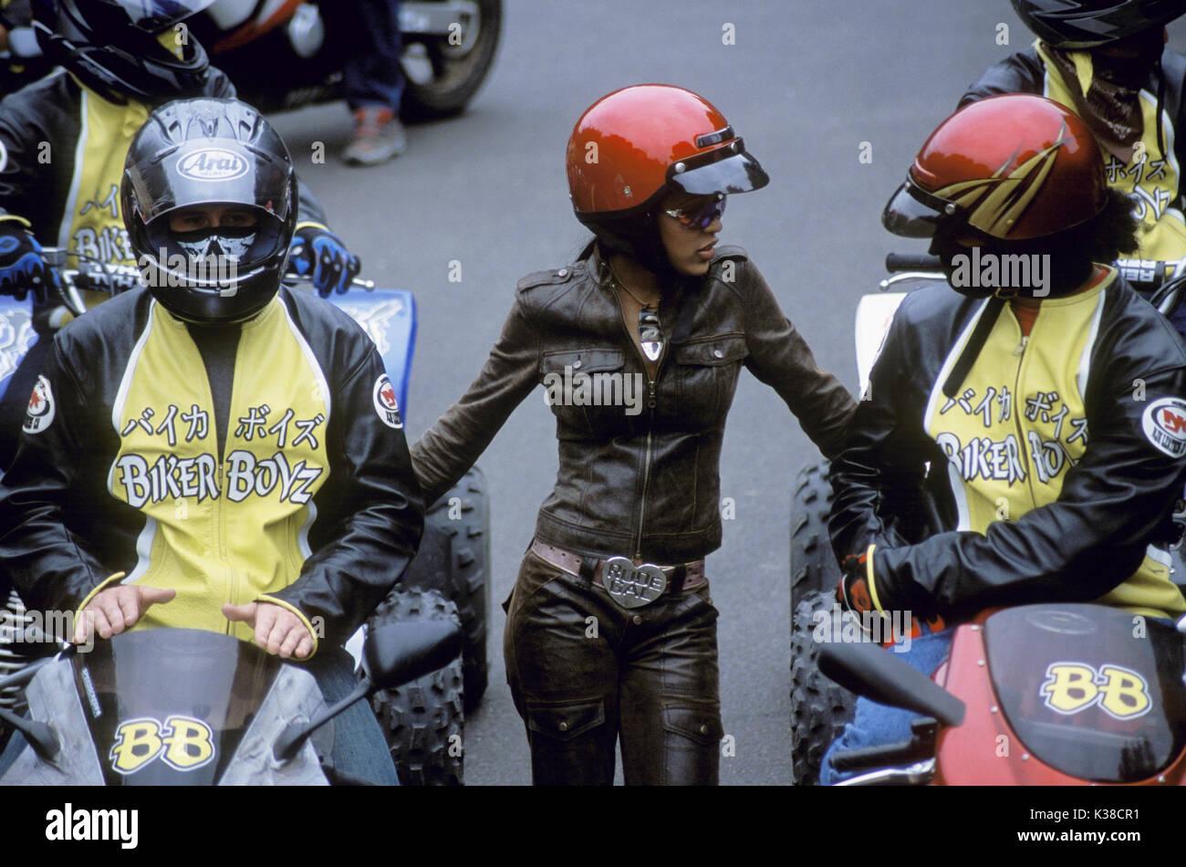 Tina gets between two members of the motorcycle racing Biker Boyz: Stuntman and Primo (RICK GONZALEZ), in BIKER BOYZ. - Stock Image