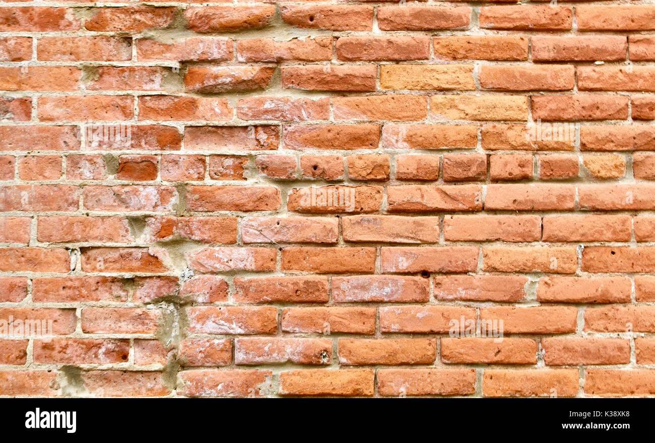 Very weathered nineteenth century red brick wall - Stock Image