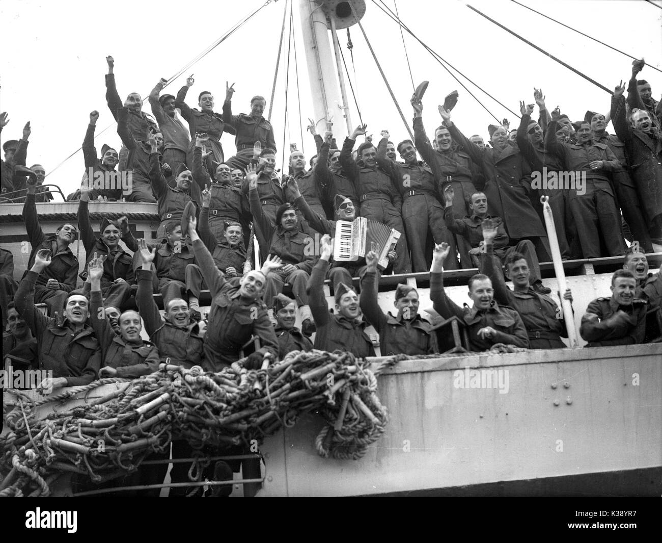 British Infantry soldiers returning home aboard troop ship during second world war - Stock Image