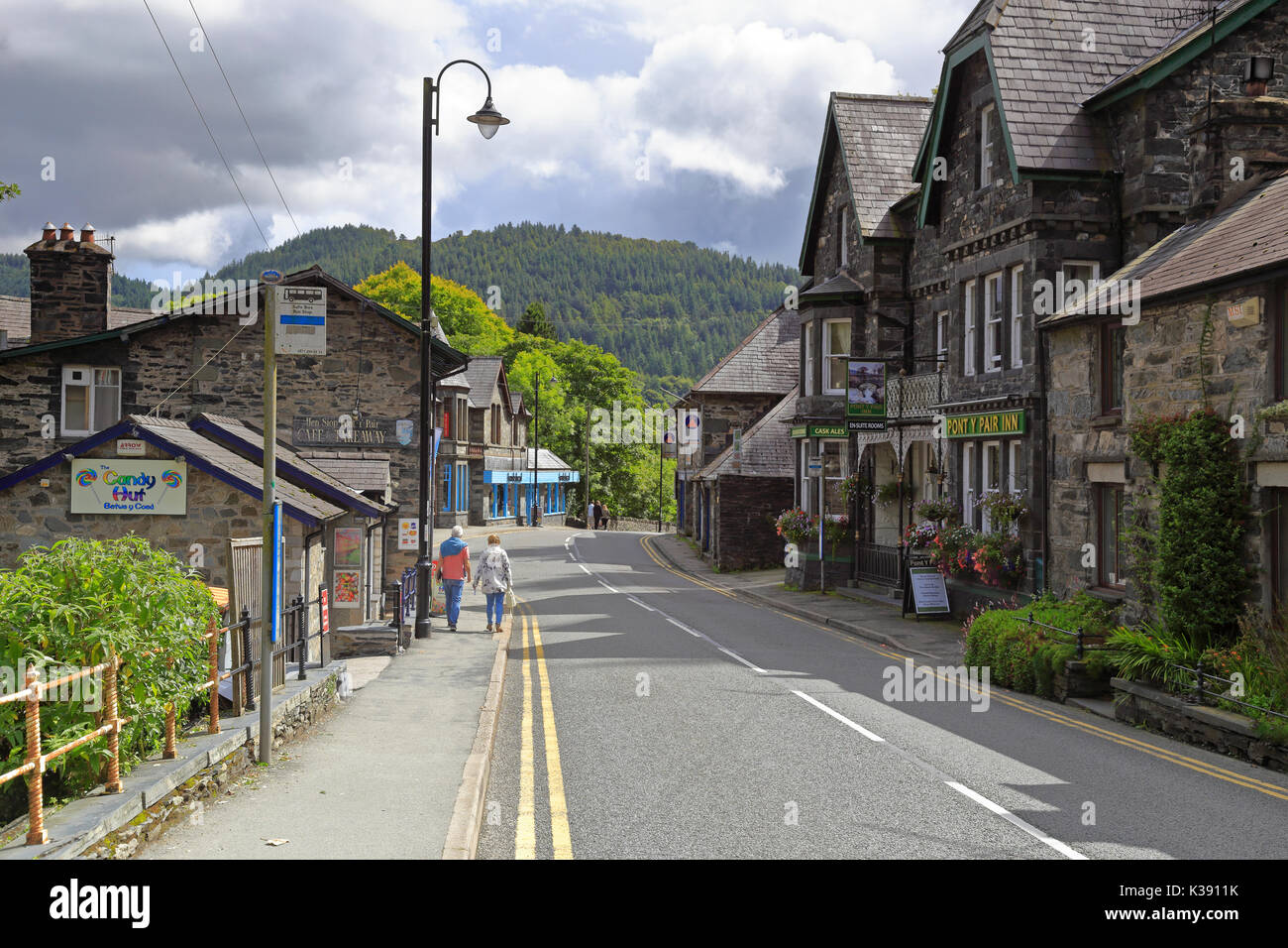 The A5 Holyhead Road through Betws-y-Coed by the Pont-y-Pair Inn, Snowdonia National Park, Conwy, North Wales, UK. - Stock Image