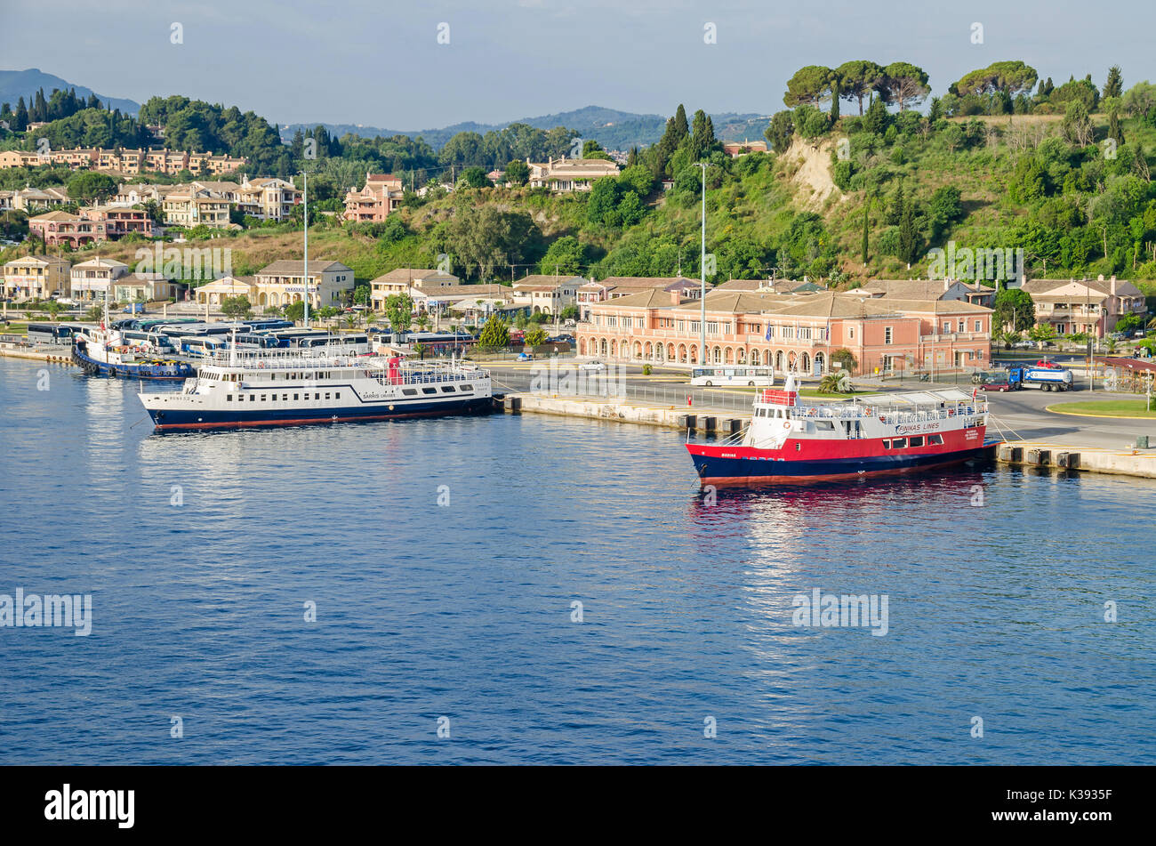Corfu, Greece - June 7, 2017: Port of the Greek island Corfu, the second largest of the Ionian Islands, with passanger terminal and ferry boats - Stock Image