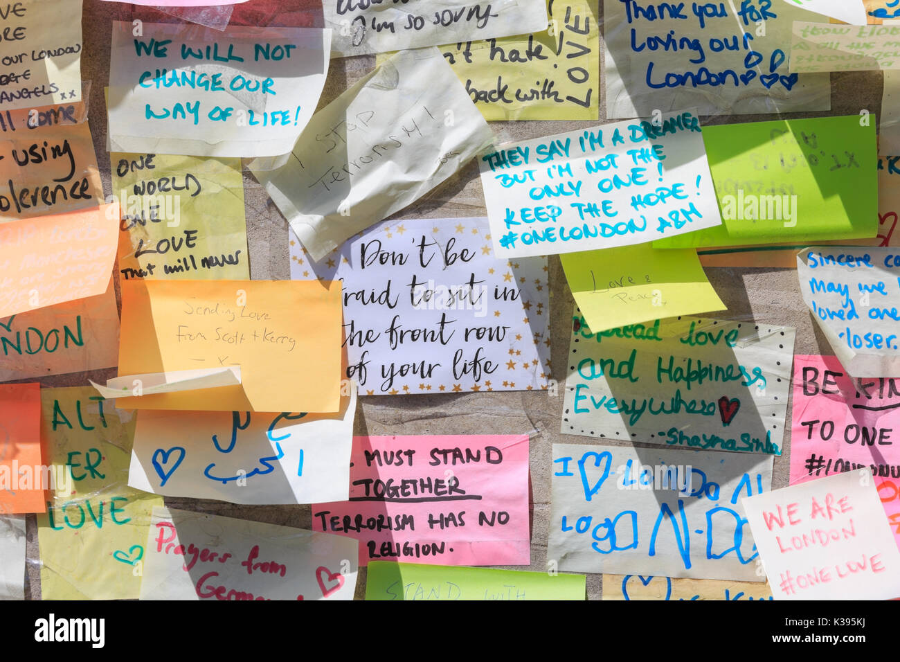 Wall of condolence cards, notes, tributes and flowers at vigil near the scene of the 2017 London Bridge and Borough Market terrorist attacks and after - Stock Image
