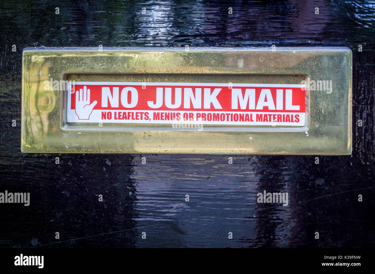 No Junk Mail sticker on a Letter Box - No Leaflets, Menus or Promotional Materials - Stock Image
