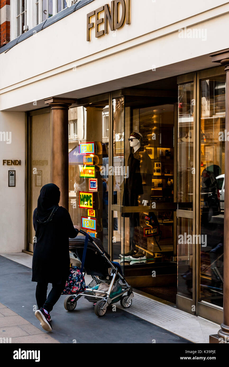 A Muslim Woman Wearing A Burka Shopping At The Fendi Luxury Fashions Store In New Bond Street, London, UK - Stock Image