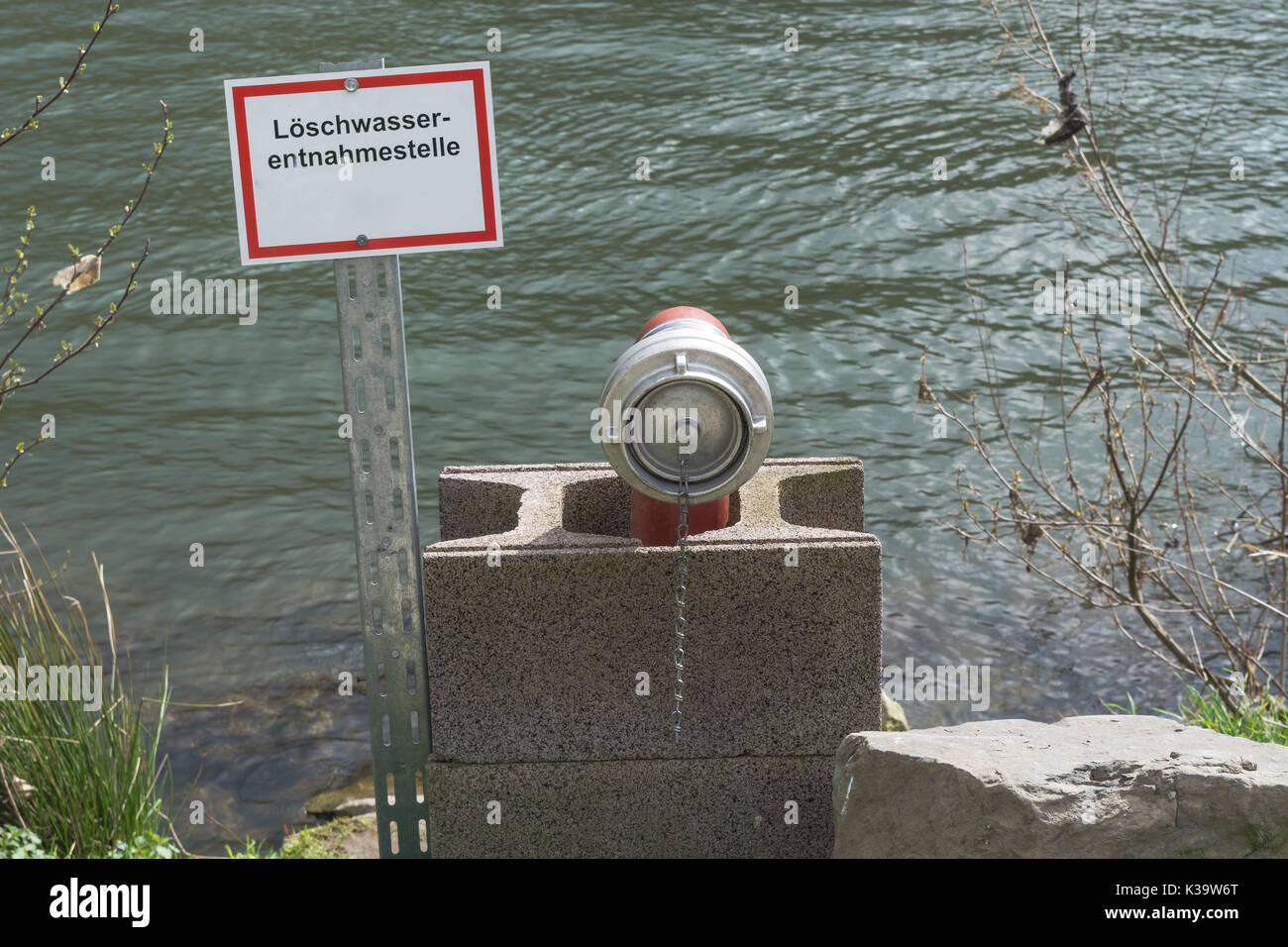 Information board with the inscription in German fire water extraction point. Firefighting Equipment in a river. - Stock Image