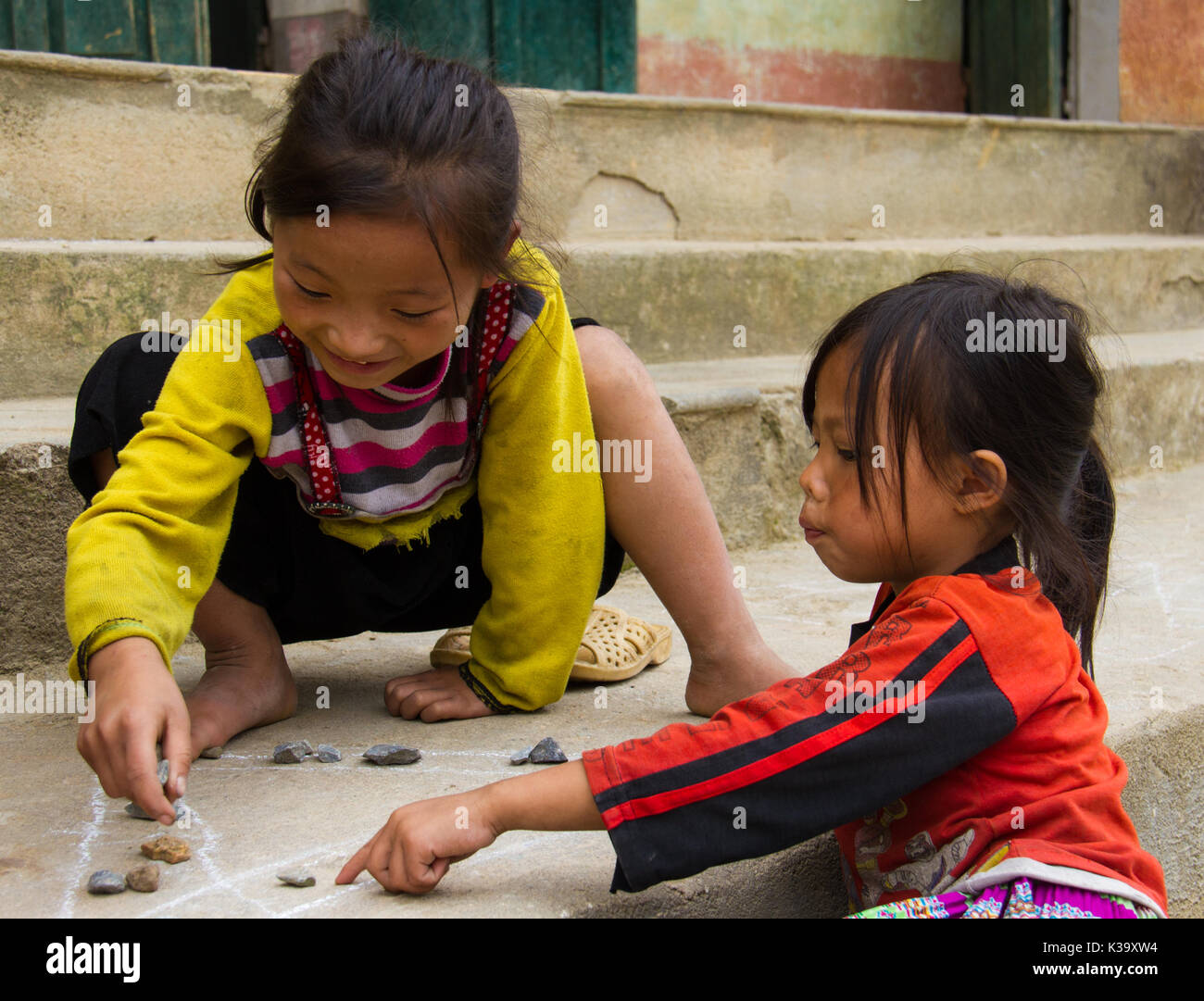 Children play game with chalk and rocks in North Vietnam on Oct 21, 2011 - Stock Image