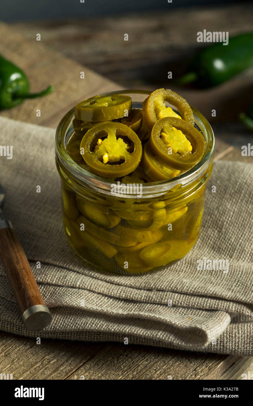 Green Organic Pickled Jalapenos in a Jar Stock Photo