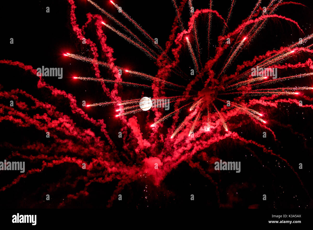 full moon night with artificial fireworks - Stock Image