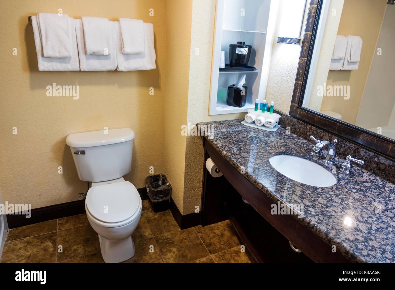 Florida Palm Coast Holiday Inn Express hotel guest room bathroom toilet vanity loo - Stock Image
