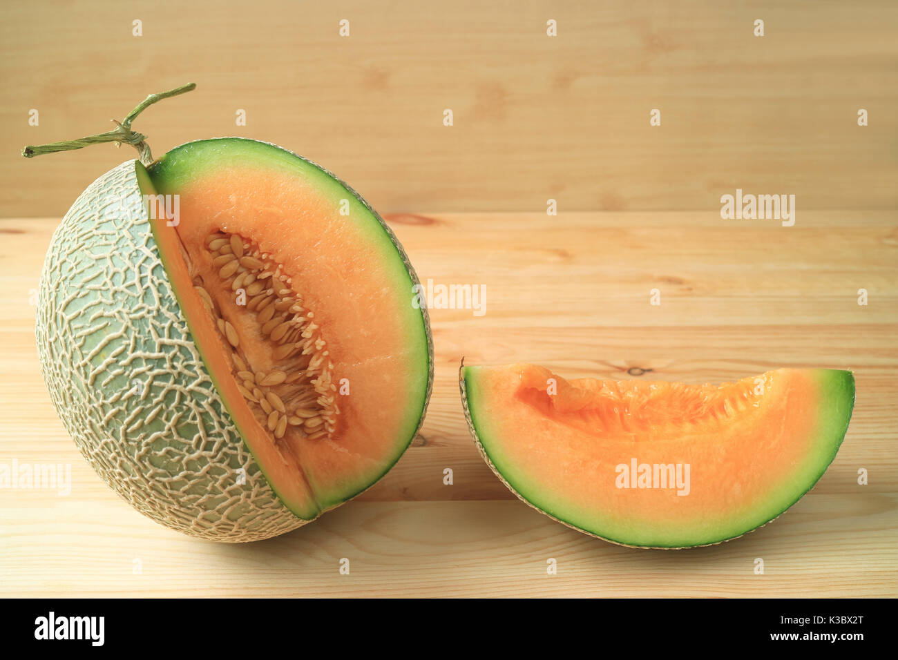 Fresh Ripe Muskmelon Sliced From The Whole Fruit Isolated On A Wooden Stock Photo Alamy Look for cantaloupes with solid rinds where the netting stands out on the surface. https www alamy com fresh ripe muskmelon sliced from the whole fruit isolated on a wooden image156999216 html