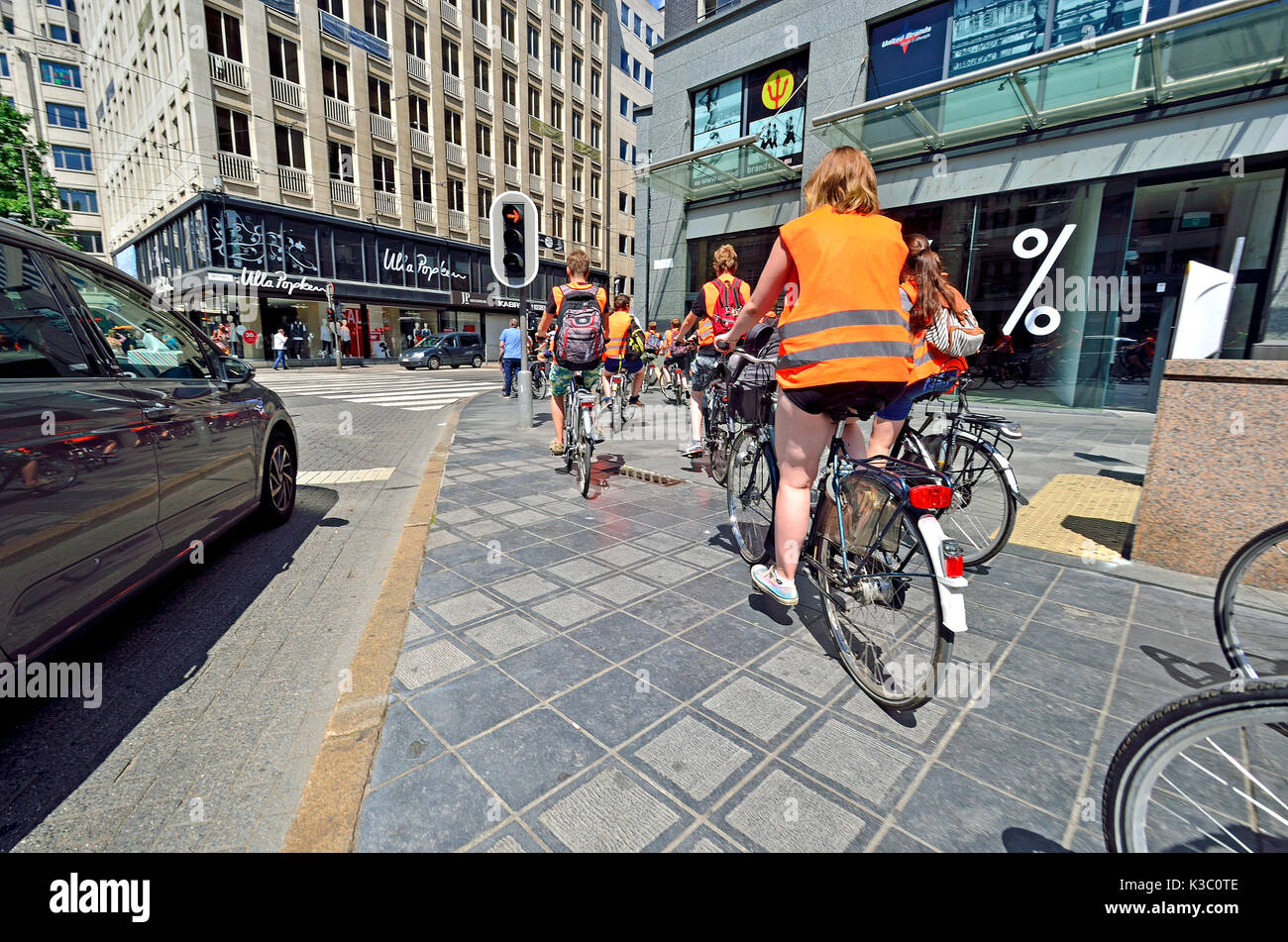 Antwerp, Belgium. Cyclists in high visibility jackets - Stock Image