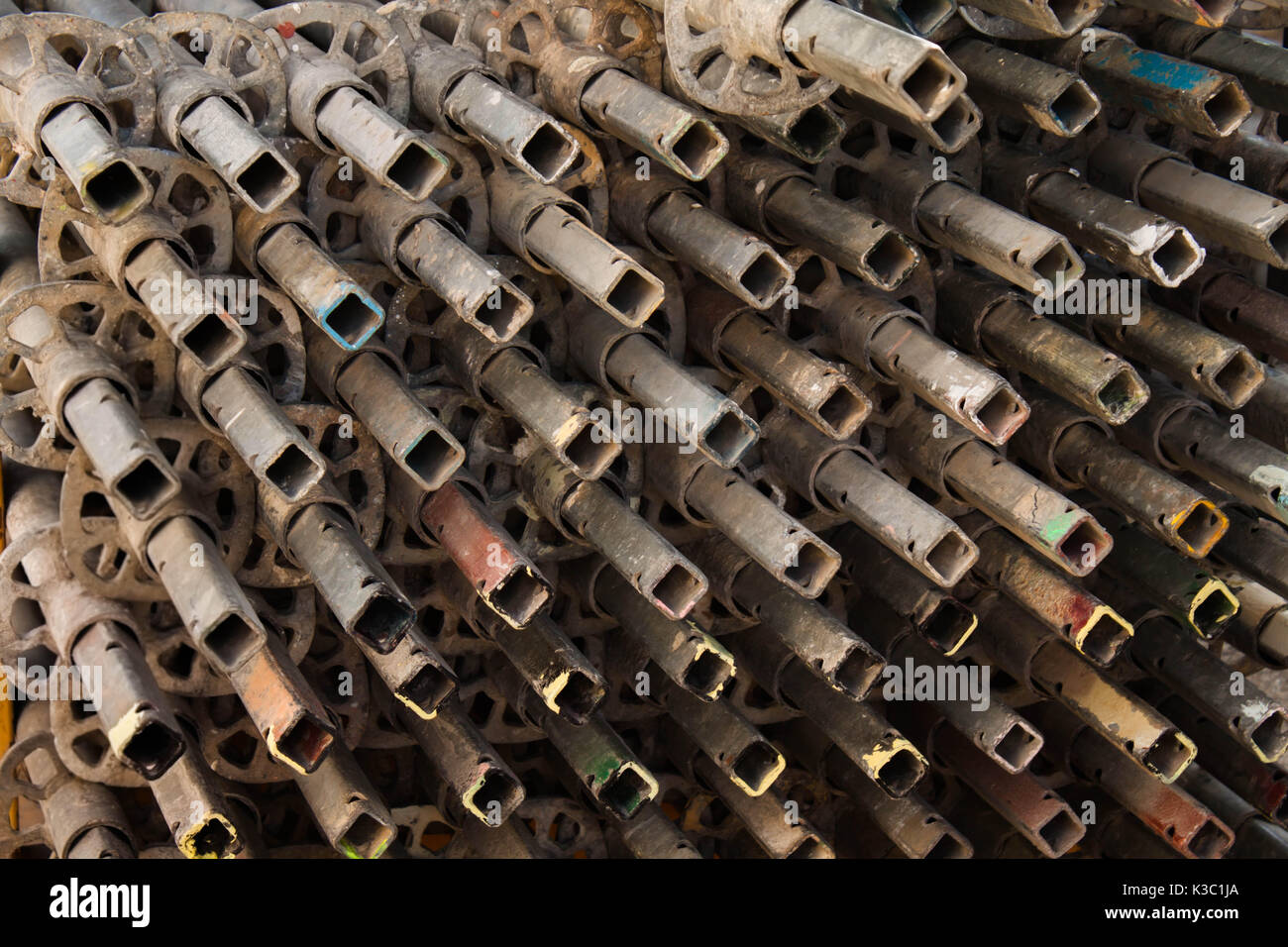 scaffold metal sqare tubes  stacked in the street close up - Stock Image
