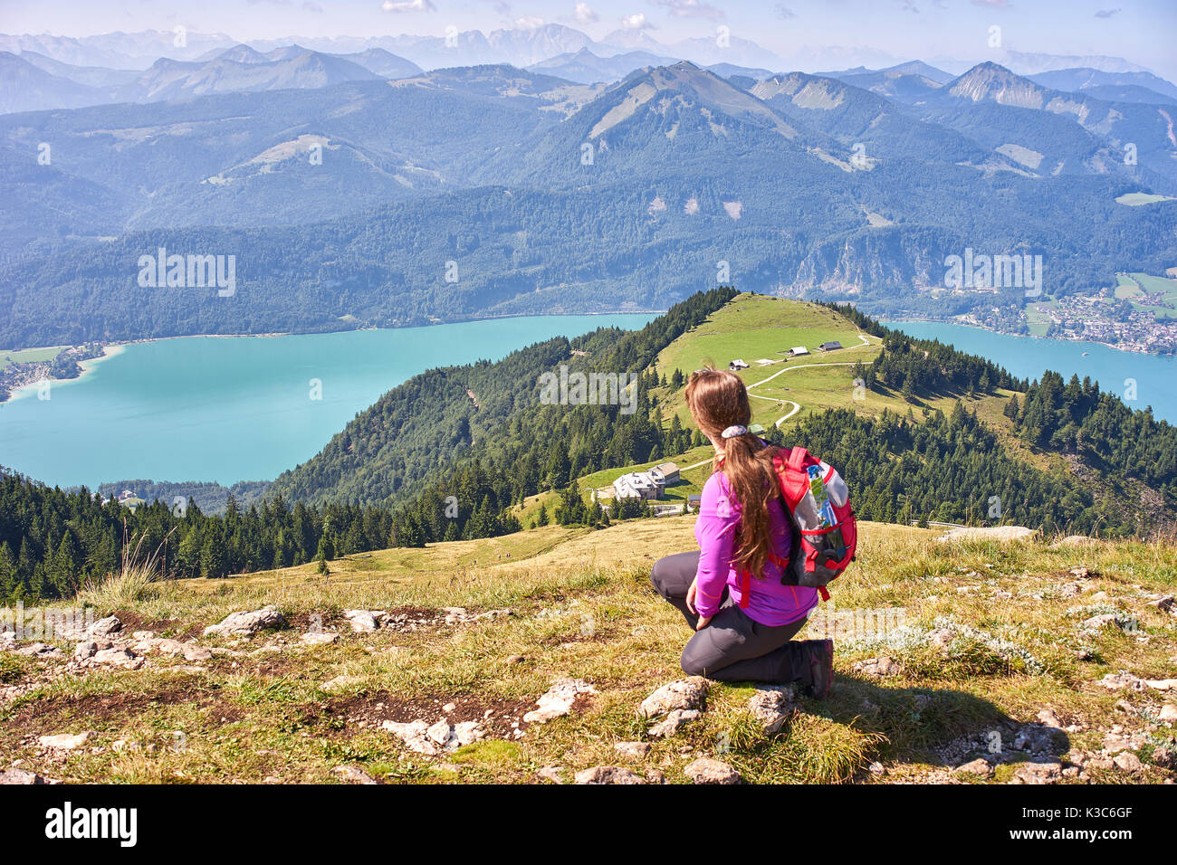 Woman with backpack in mountains - Stock Image