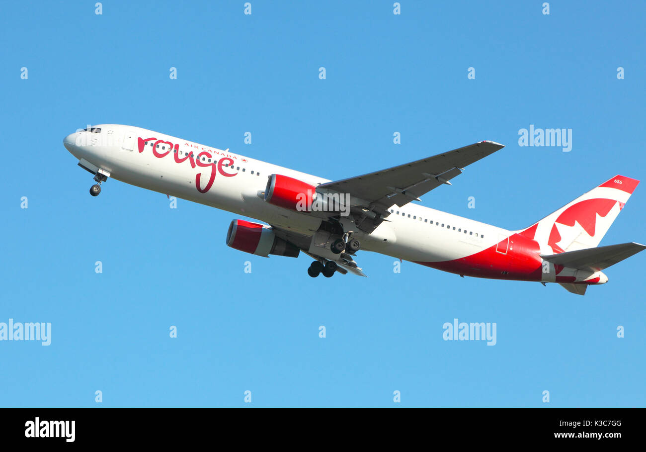 Air Canada,Rouge Boeing 767-300 ER leaves Edinburgh Airport - Stock Image
