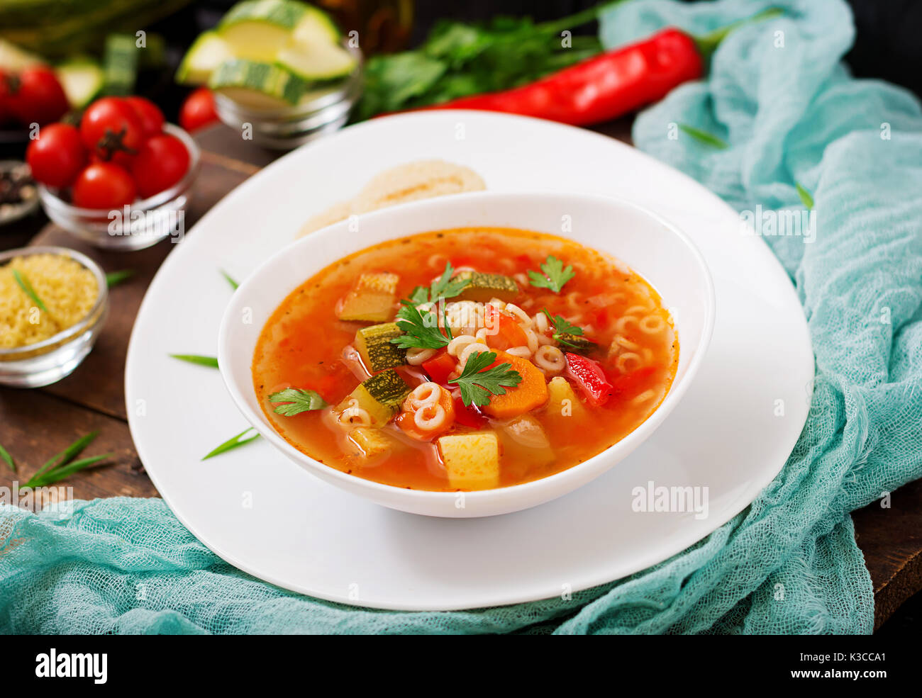 """Minestrone - """"big soup"""", soup with many ingredients - a dish of Italian cuisine, light seasonal vegetable soup with Stock Photo"""